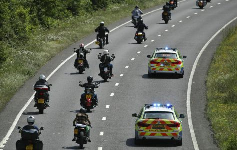 Police escort members of the Hells Angels Motorcycle Club