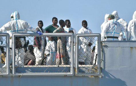 Italian ship with rescued migrants docks in Genoa