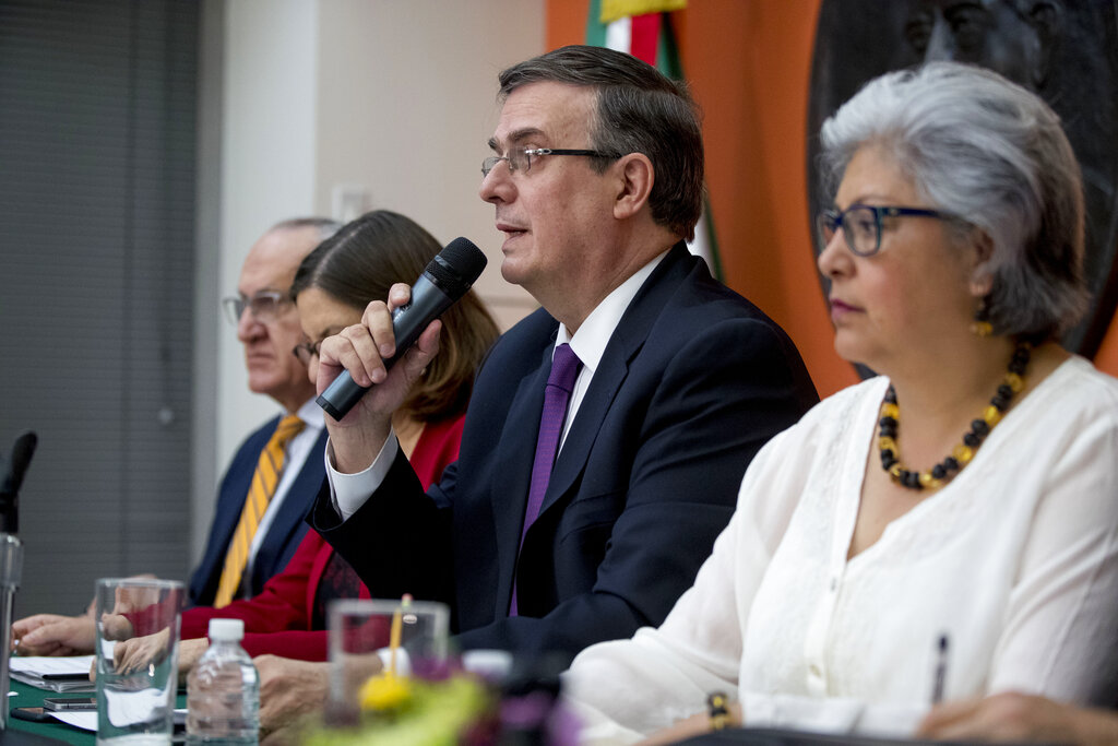 Mexican Foreign Affairs Secretary Marcelo Ebrard, center, speaks at a news conference at the Mexican Embassy in Washington on Monday. A Mexican delegation is also arriving in Washington for talks following trade tariff threats from the Trump Administration.