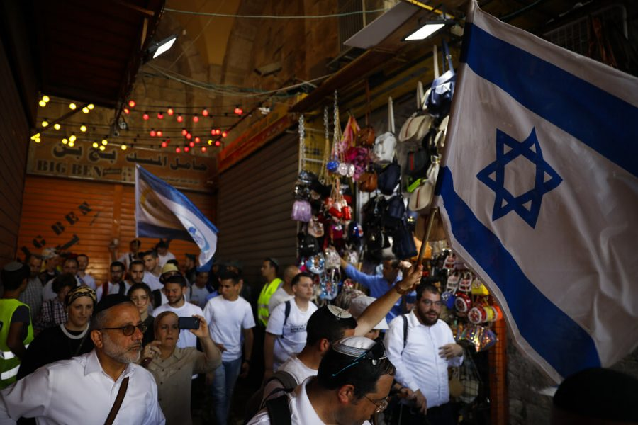 Israelis wave national flags in Jerusalem's Old City on June 2, 2019, during Jerusalem Day, an Israeli holiday celebrating the capture of the Old City during the 1967 Mideast war.