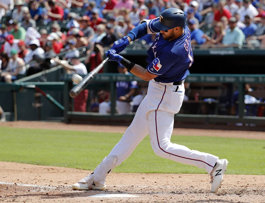 Texas Rangers' Joey Gallo connects for a two-run home run off a pitch from Kansas City Royals' Homer Bailey in the fourth inning of a baseball game in Arlington, Texas, on June 1, 2019.