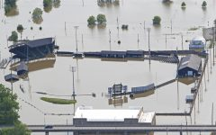 In central US, levee breaches flood some communities