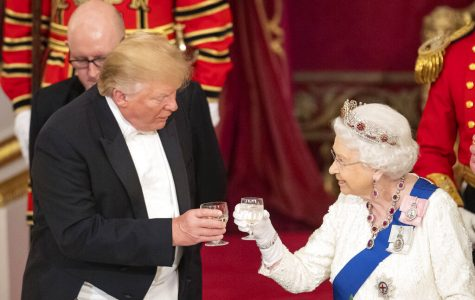 President Donald Trump and Queen Elizabeth II toast during the State Banquet at Buckingham Palace in London on Monday. Trump is on a three-day state visit to Britain.