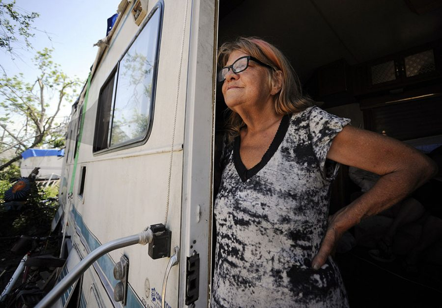 woman looking out from her trailer