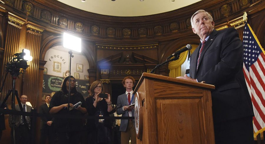 Missouri Gov. Mike Parson listens as a member of the media asks a question during a press conference in his Jefferson City, Mo., Capitol office Wednesday regarding the state of operations of a Planned Parenthood facility in St. Louis. The clinic has two days to remedy the issues found or face non-renewal of their operating license. Julie Smith/The Jefferson City News-Tribune