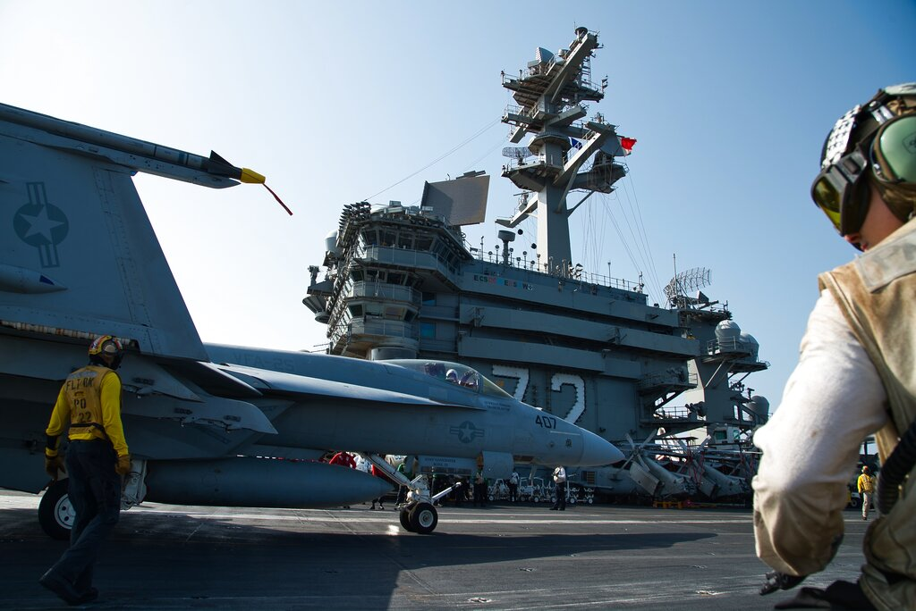 An F/A-18 fighter jet taxis on the deck of the USS Abraham Lincoln aircraft carrier in the Arabian Sea, Monday, June 3.