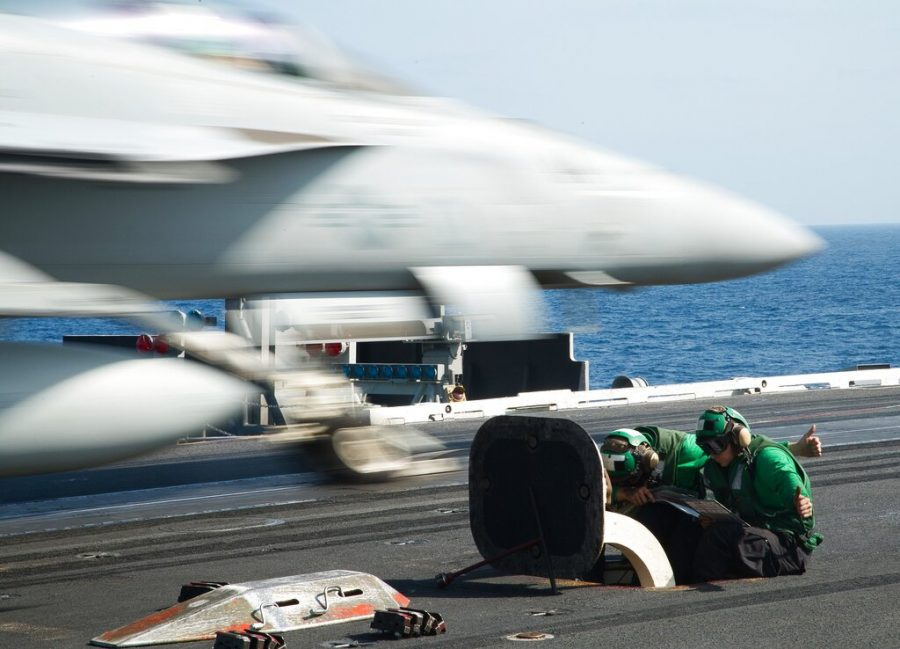 An F/A-18 fighter jet takes off from the deck of the USS Abraham Lincoln aircraft carrier in the Arabian Sea on Monday, June 3, 2019. The U.S. aircraft carrier the White House ordered to the Mideast over a perceived threat from Iran remains outside of the Persian Gulf amid efforts to de-escalate tensions between Tehran and Washington. (AP Photo/Jon Gambrell)
