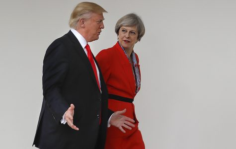 Donald Trump walks with Theresa May