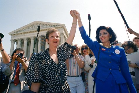 A young Norma McCorvey and her attorney Gloria Allred hold hands and lift them in celebration as they leave the Supreme Court building in Washington. The photo was taken April 26, 1989.