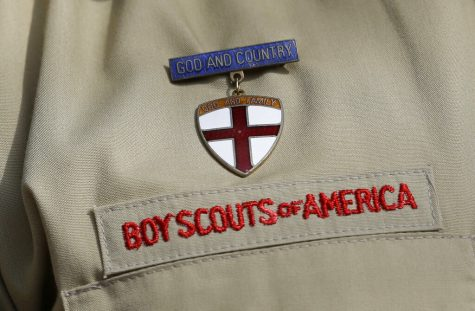 This photo shows a close up of a Boy Scout uniform badge during a news conference in front of the Boy Scouts of America headquarters in Irving, Texas. Victims of childhood sex abuse suing the Boy Scouts of America in New Jersey, New York, California and a handful of other states that loosened their statutes of limitations in 2019 will effectively face an earlier deadline to press claims because of a date set in federal bankruptcy proceedings.