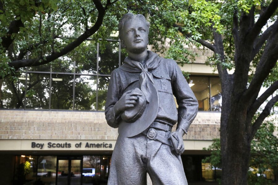 In this Feb. 12 photo, a statue stands outside the Boys Scouts of America headquarters in Irving, Texas.  Some victims of childhood sex abuse who are considering suing the Boy Scouts of America must rush to do so or perhaps face a greater risk of losing. Attorneys for the Scouts and victims agreed this month on a Nov. 16 deadline for victims to make a claim or be barred from bringing one later.