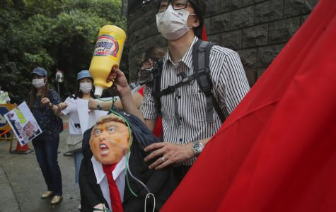 Pro-China supporters protest in Hong Kong, Saturday, May 30, 2020. President Donald Trump has announced a series of measures aimed at China as a rift between the two countries grows. He said Friday that he would withdraw funding from the World Health Organization, end Hong Kong's special trade status and suspend visas of Chinese graduate students suspected of conducting research on behalf of their government.