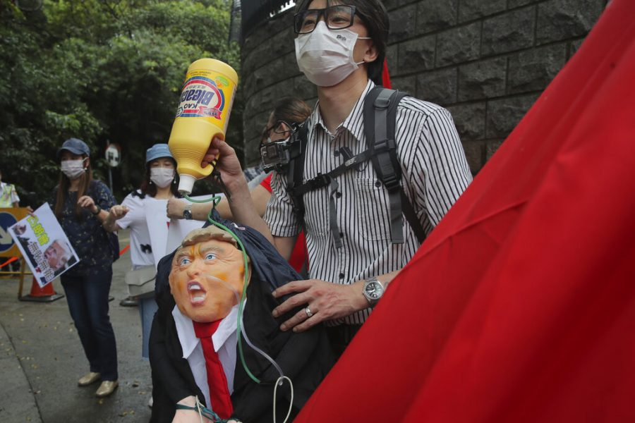 Pro-China+supporters+protest+in+Hong+Kong%2C+Saturday%2C+May+30%2C+2020.+President+Donald+Trump+has+announced+a+series+of+measures+aimed+at+China+as+a+rift+between+the+two+countries+grows.+He+said+Friday+that+he+would+withdraw+funding+from+the+World+Health+Organization%2C+end+Hong+Kong%27s+special+trade+status+and+suspend+visas+of+Chinese+graduate+students+suspected+of+conducting+research+on+behalf+of+their+government.