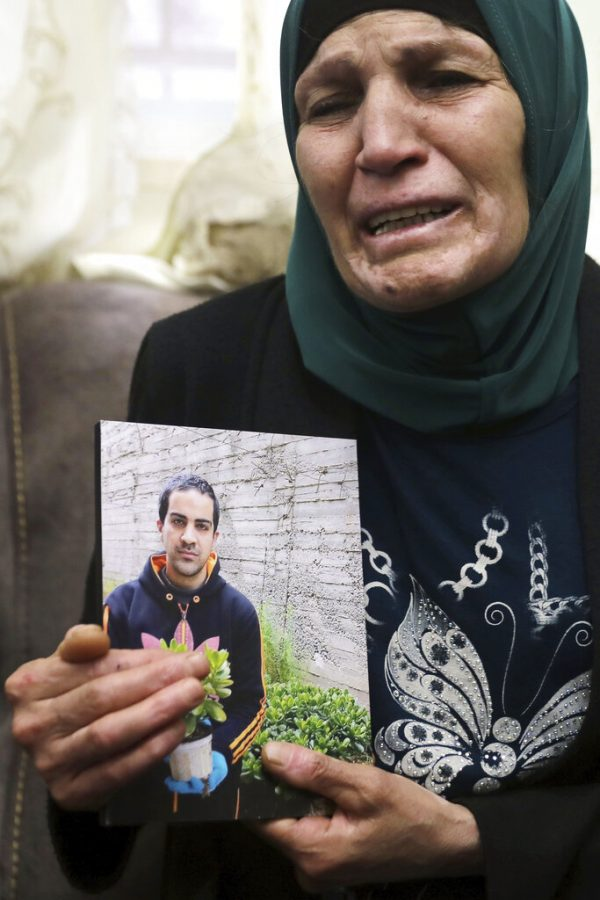 Woman mourns the loss of her son.