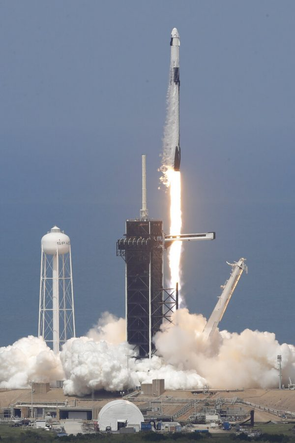 The SpaceX Falcon 9 and the Crew Dragon capsule, with NASA astronauts Bob Behnken and Doug Hurley onboard, lifts off on May 30, 2020, at the Kennedy Space Center in Cape Canaveral, Fla.