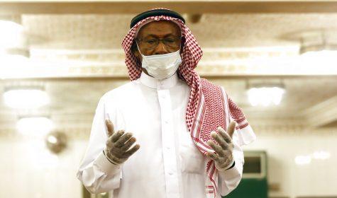 A Saudi worshipper wears a white face mask and gloves as he prays dawn prayers at al-Mirabi Mosque in Jiddah, Saudi Arabia on May 31.