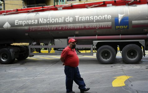 A tanker truck supplies gasoline to a state oil company gas station in Caracas, Venezuela, May 31. After decades of being the cheapest gasoline in the world, Venezuelan President Nicolas Maduro indicates that as of next Monday a new pricing scheme will be imposed on some 200 stations.