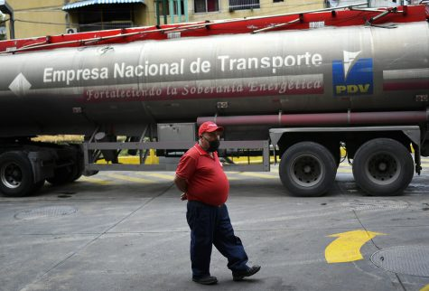 "A tanker truck supplies gasoline to a state oil company gas station in Caracas, Venezuela, May 31. After decades of being the cheapest gasoline in the world, Venezuelan President Nicolas Maduro indicates that as of next Monday a new pricing scheme will be imposed on some 200 stations. ""The time has come to move toward a new policy, toward a new normality, toward a new situation,"" Maduro said."