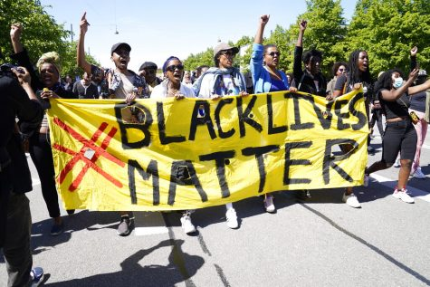 Protesters carry a Black Lives Matter banner