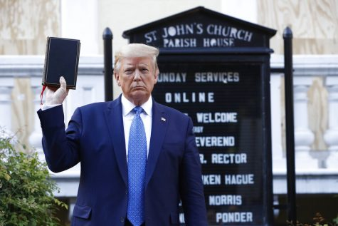 President Trump holds up a Bible.