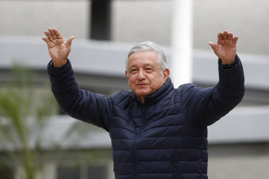 Mexican President Andres Manuel Lopez Obrador waves to supporters