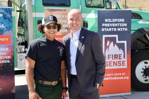 Utah Gov. Spencer Cox stands with resident during wildfire campaign.