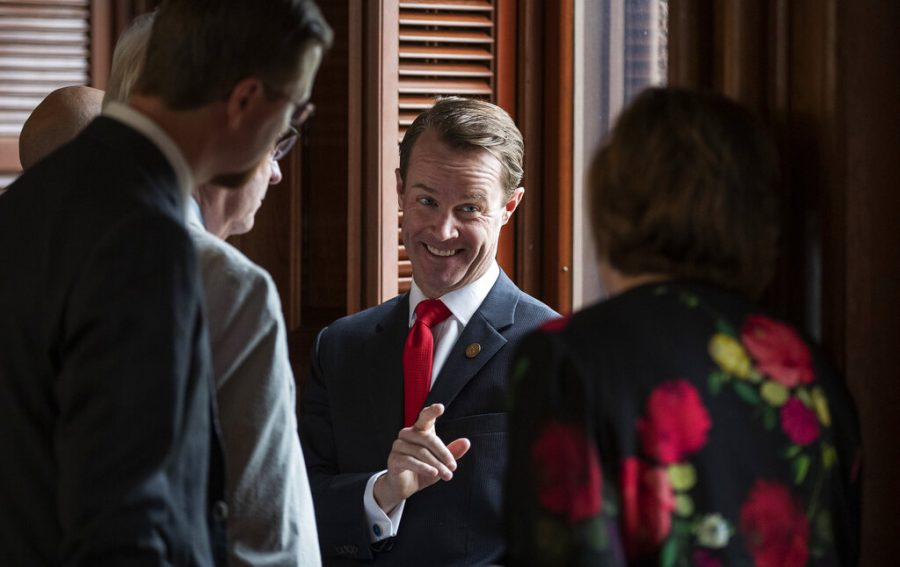 House Speaker Dade Phelan, R-Beaumont, talks to Republican members of the Texas House before the start of the debate of Senate Bill 7, known as the Election Integrity Protection Act, at the Capitol on May 30, 2021, in Austin, Texas.