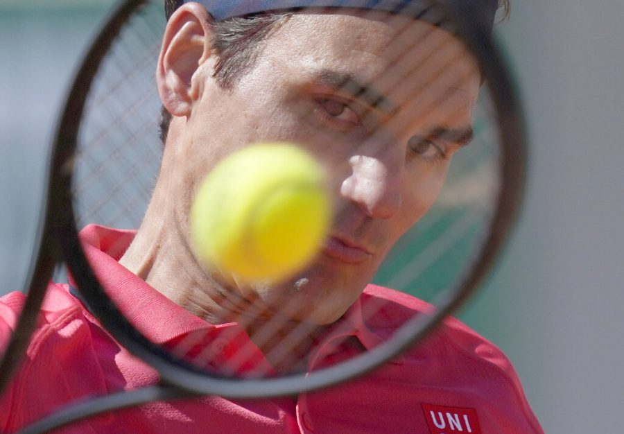 Switzerland's Roger Federer plays a return to Uzbekistan's Denis Istomin during their first round match on day two of the French Open tennis tournament at Roland Garros in Paris, France on May 31.