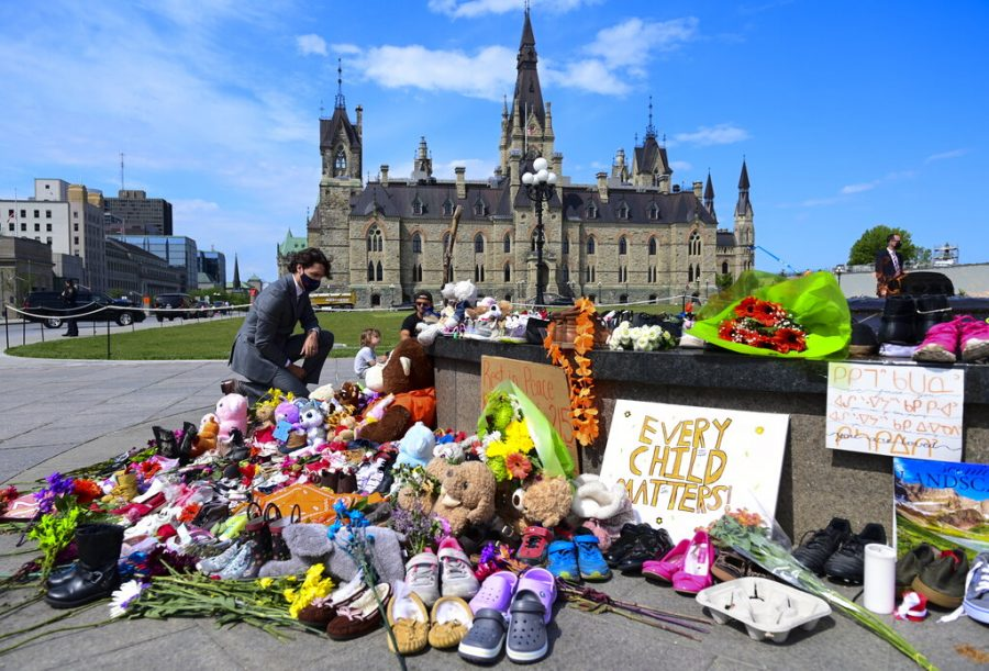 Canadian+Prime+Minister+Justin+Trudeau+pays+tribute+to+a+memorial.
