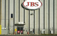 A worker heads into the JBS meatpacking plant in Greeley, CO. The White House confirms that JBS notified the U.S. government May 30, 2021, of a ransom demand from a criminal organization likely based in Russia.