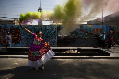 Marven launches colorful smoke flares during her campaign event for a seat on Mexico City