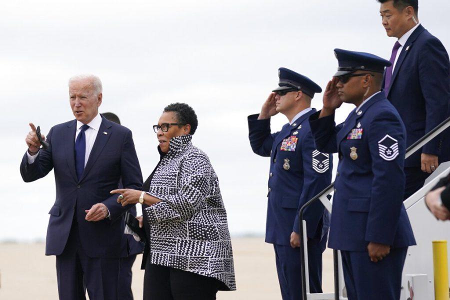 President Joe Biden walks with Housing and Urban Development Secretary Marcia Fudge as he arrives in Tulsa, Okla., Tuesday, June 1, 2021. (AP Photo/Evan Vucci)