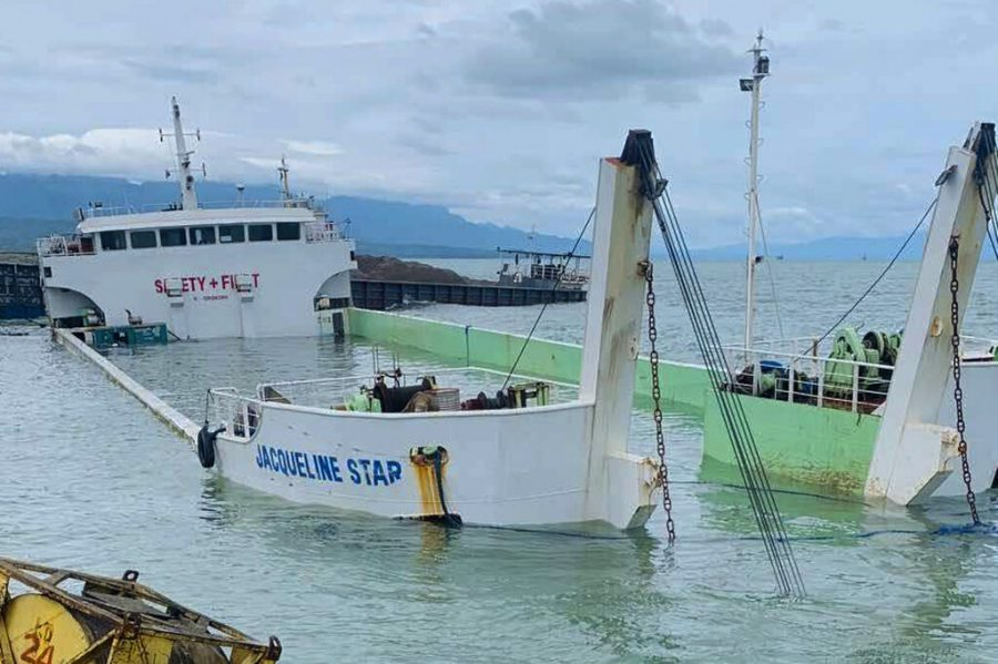 In this photo provided by the Philippine Coast Guard, a half-submerged LCT Jacqueline star ship is seen after its crew abandoned ship as Tropical Storm Choi-wan hits Albuera, Leyte province, central Philippines on Wednesday June 2, 2021. The tropical storm has left several people dead and displaced hundreds of villagers in the southern and central Philippines, where it set off flooding and landslides, officials said Wednesday. (Philippine Coast Guard via AP)