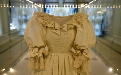 Princess Dianas dress on display in a glass case.