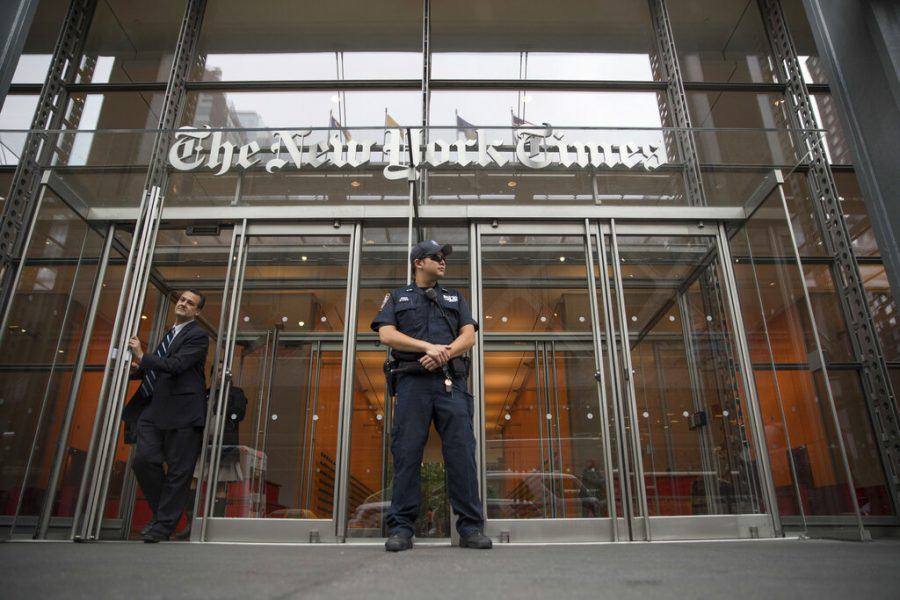 Police officer outside of New York Times building