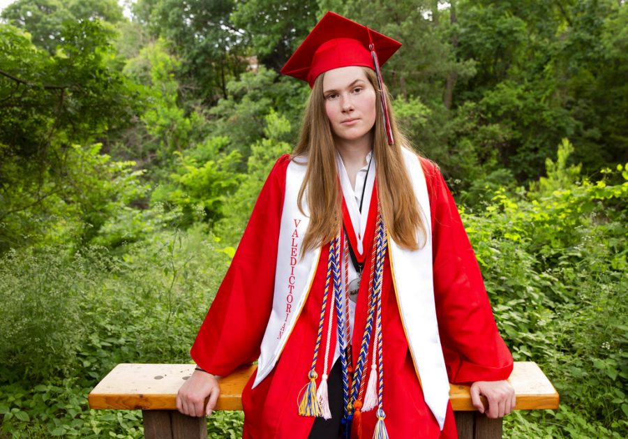 Paxton Smith poses in graduation cap and gown