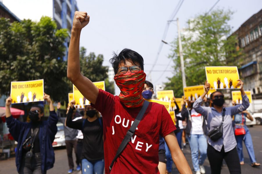 Protester raises his fist in a Myanmar march