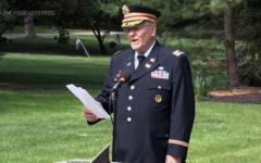 Retired Army Lt. Col. Barnard Kemter reading the speech at a park.