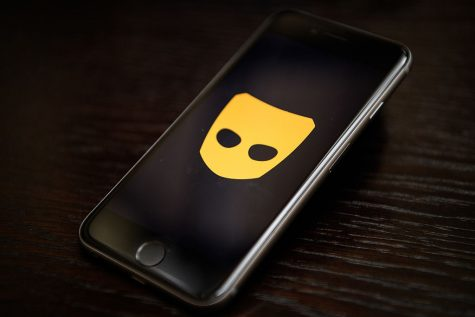 The Grindr app logo is seen on a mobile phone screen on November 24, 2016. Following a number of deaths linked to the use of anonymous online dating apps, the police have warned users to be aware of the risks involved, following the growth in the scale of violence and sexual assaults linked to their use.