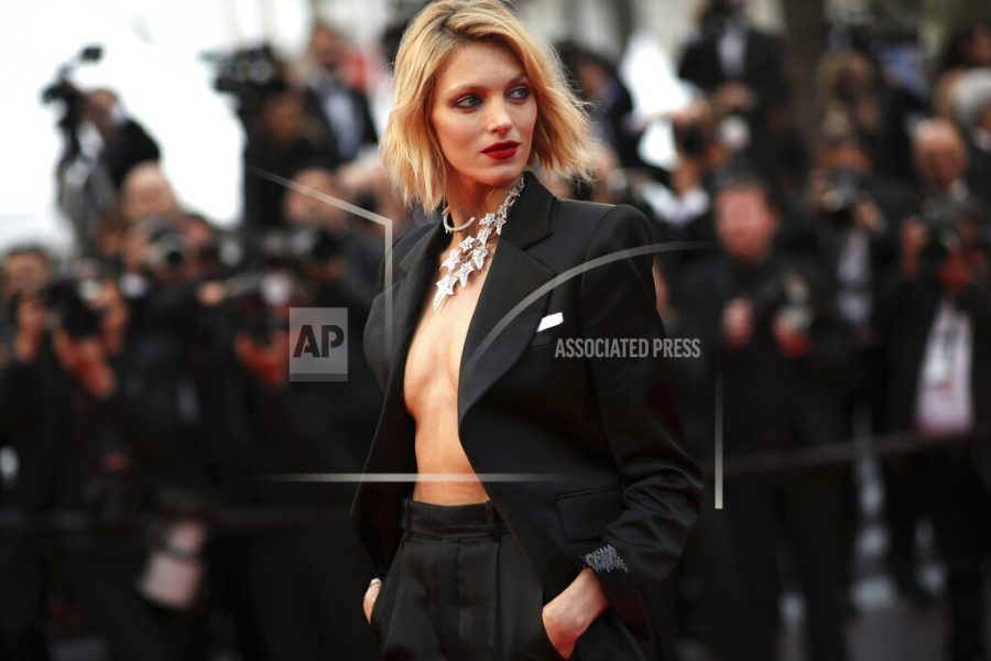 """FILE - In this Friday, May 17, 2019 file photo, model Anja Rubik poses for photographers at the 72nd international film festival, Cannes, southern France. A Nobel laureate, a Netflix star and a fashion model are among the board members who helped launch an initiative Tuesday, June 1, 2021 to raise money for LGBT rights groups in Poland, where gay men, lesbians, and bisexual and transgender people face a backlash from the country's conservative government and Catholic Church. """"We can't count on aid from within the country,"""" said model Anja Rubik, who is one of the board members. (AP Photo/Petros Giannakouris, file)"""